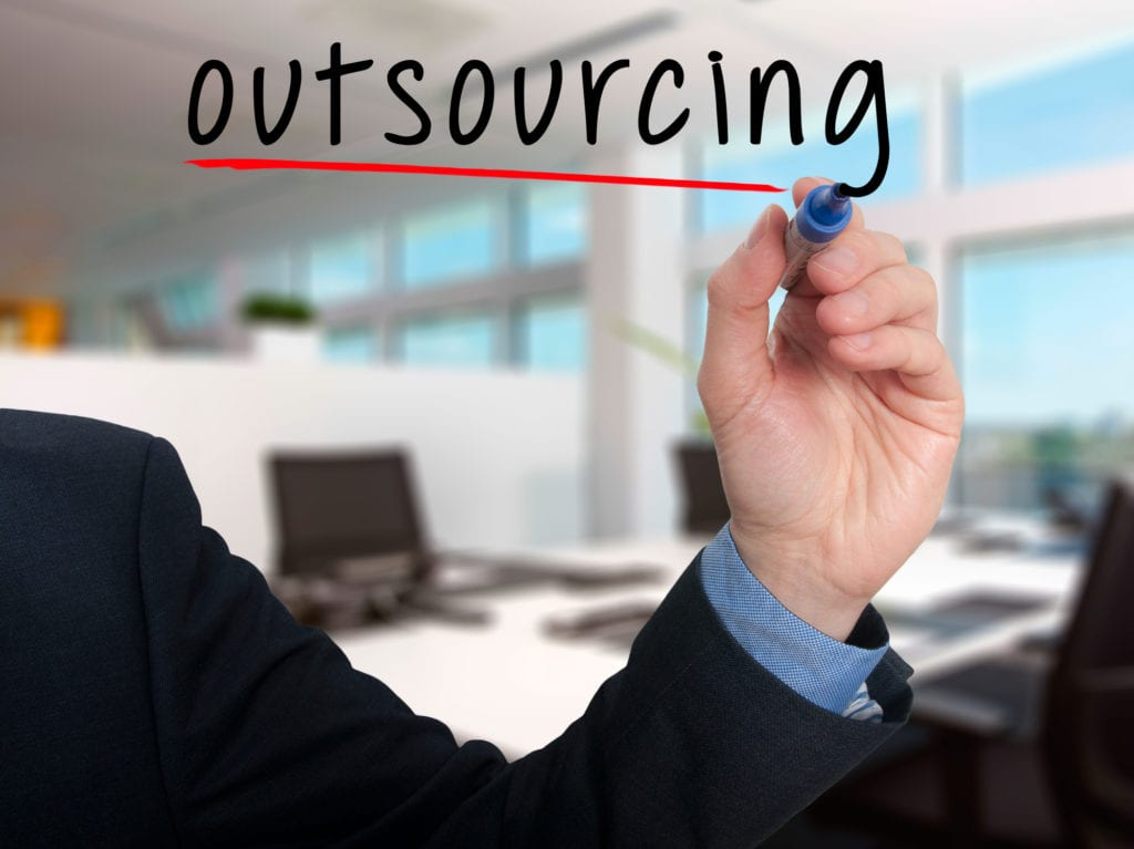 Business man writing outsourcing